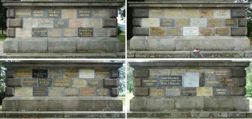 Podstavec pomníku tvoří pravidelný čtyřboký hranol z kamenných kvádrů, ve kterém vsazeno 67 kvádrů z různých mís Čech a nápisy označujícími dárce kamene a místa původu kamene. Dárci jsou obce, spolky a osoby z Česka i mimo Česko.